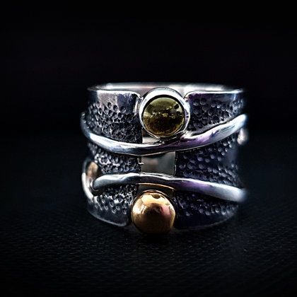 Sterling silver ring with tourmaline and gold bead.