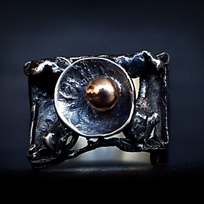 Oxidized silver ring with gold bead